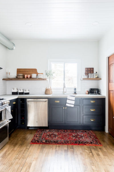 Dark inset cabinets, wood accents, mixed metals and industrial appliances give this Rustic Modern Kitchen a cozy, clean look.