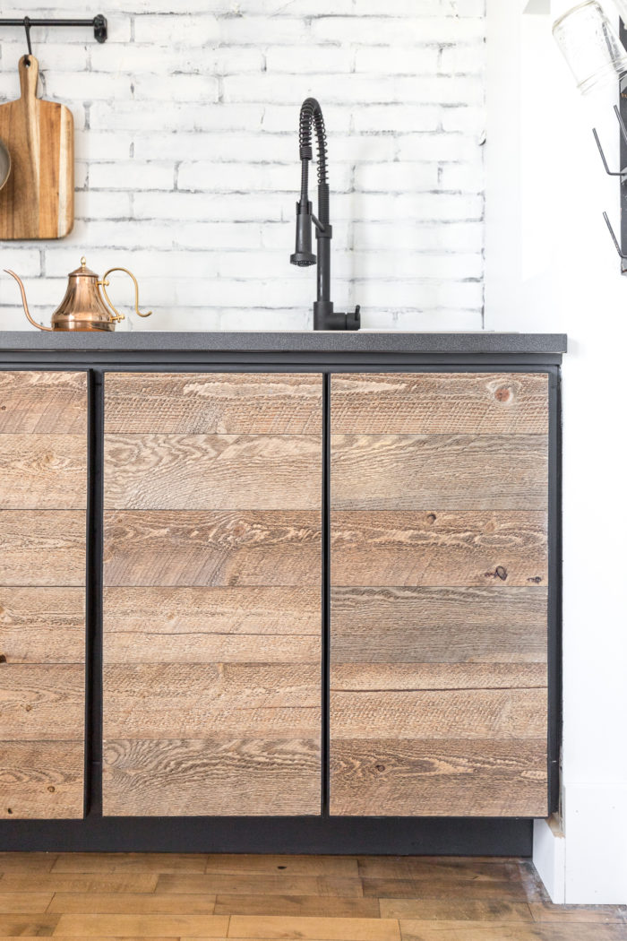 Create the look of reclaimed cabinet doors by using shiplap from Home Depot