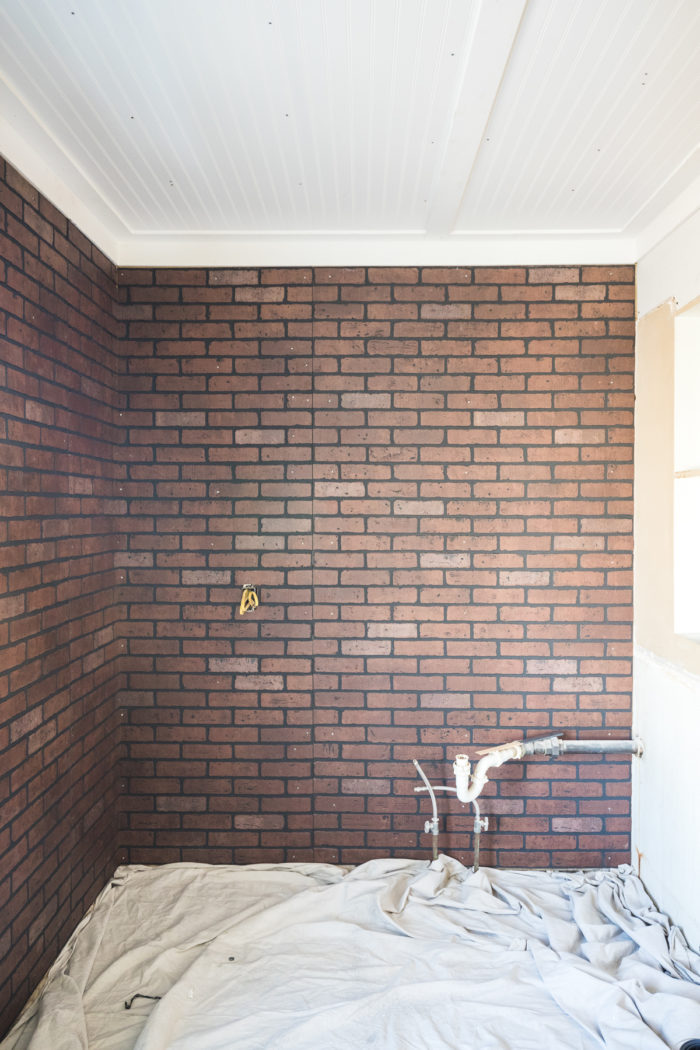 Brick wall panels used to create a faux brick wall in a kitchenette.