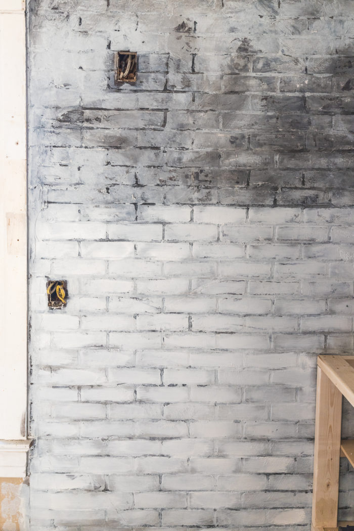 dry brush white paint over the faux brick wall to give the appearance of old worn brick with layers of paint.