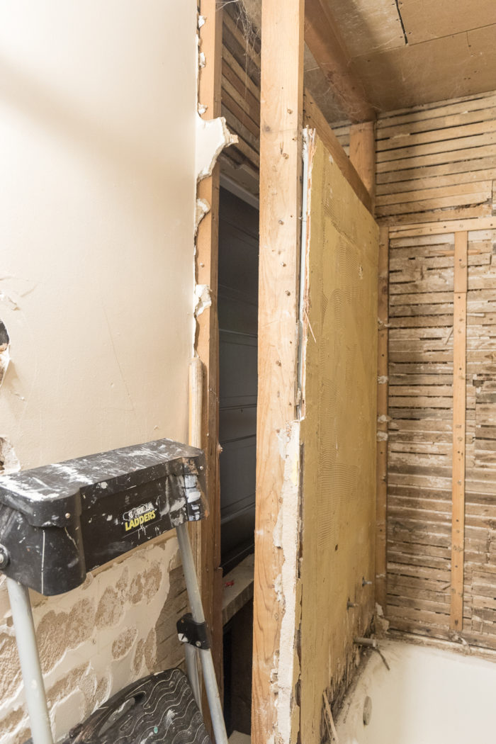 Extend closet into bathroom by reframing the walls