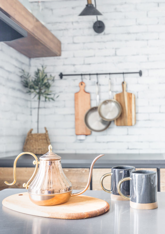 Take a tour of this Rustic Industrial Kitchenette inspired by coffee shops from all over! Full of DIY projects this little space is gentle on any budget!
