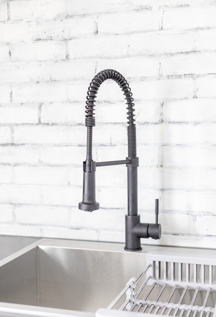 Stylish Black faucet in Kitchenette.