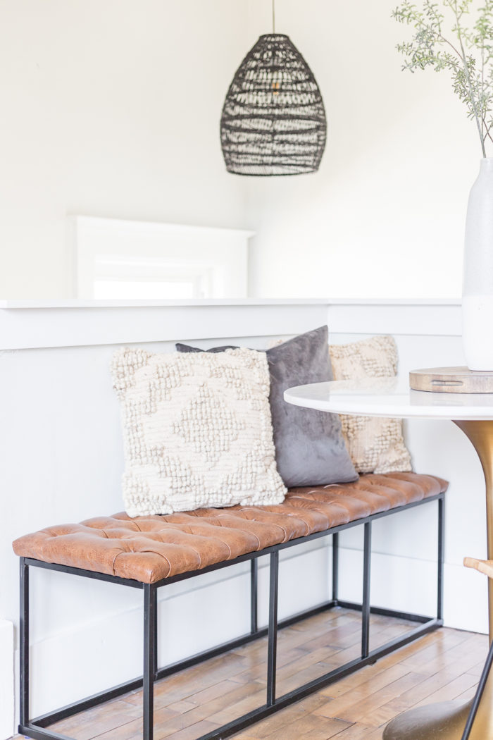 Use a bench next to a small round table to maximize seating.