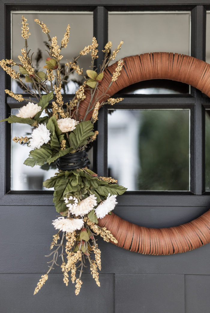 Modern Fall Wreath with Neutral Flowers on a black door.