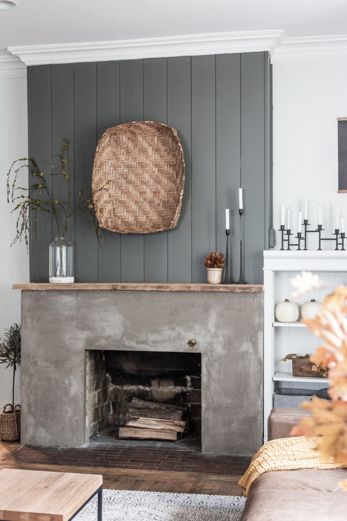 Green Shiplap above concrete fireplace with Modern Traditional Fall Decor.