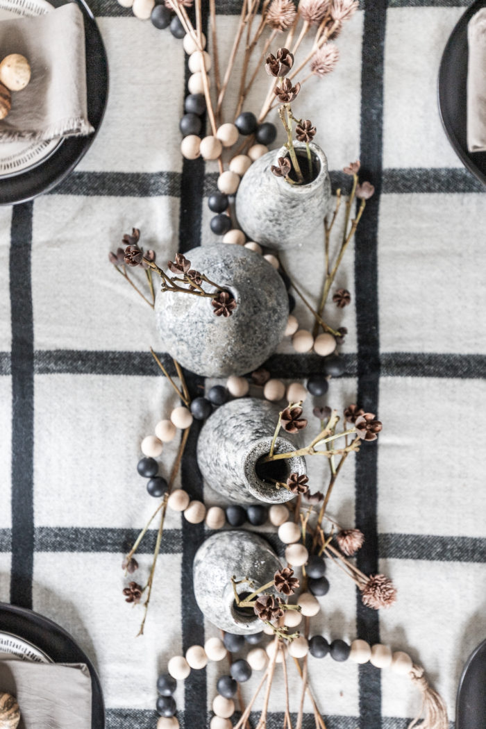 Gray vases and modern natural decor for a Thanksgiving Tablescape.