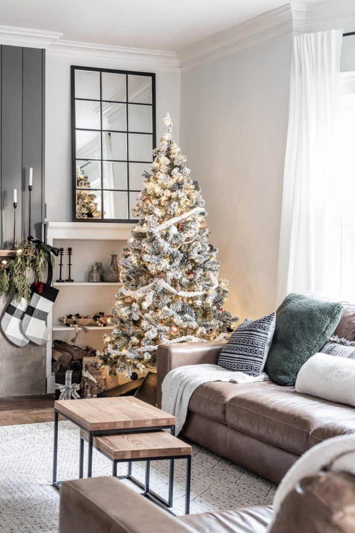 Modern Rustic Christmas Tree in front of built ins.