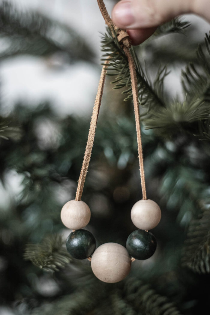 Natural and painted wooden beads used as Christmas Ornaments.