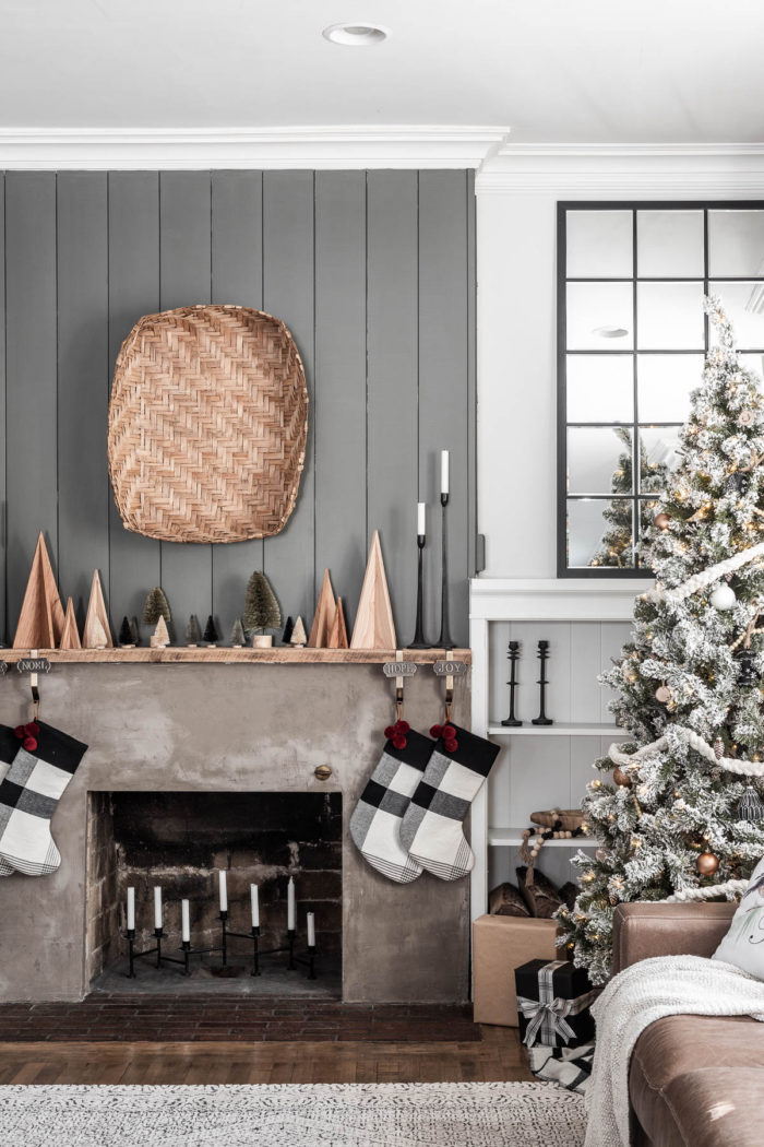 Modern Rustic Christmas Mantel Decor with Cozy Tree in front of built-ins.