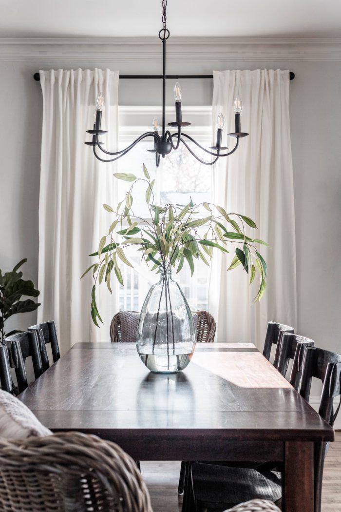 formal dining room with large jug vase