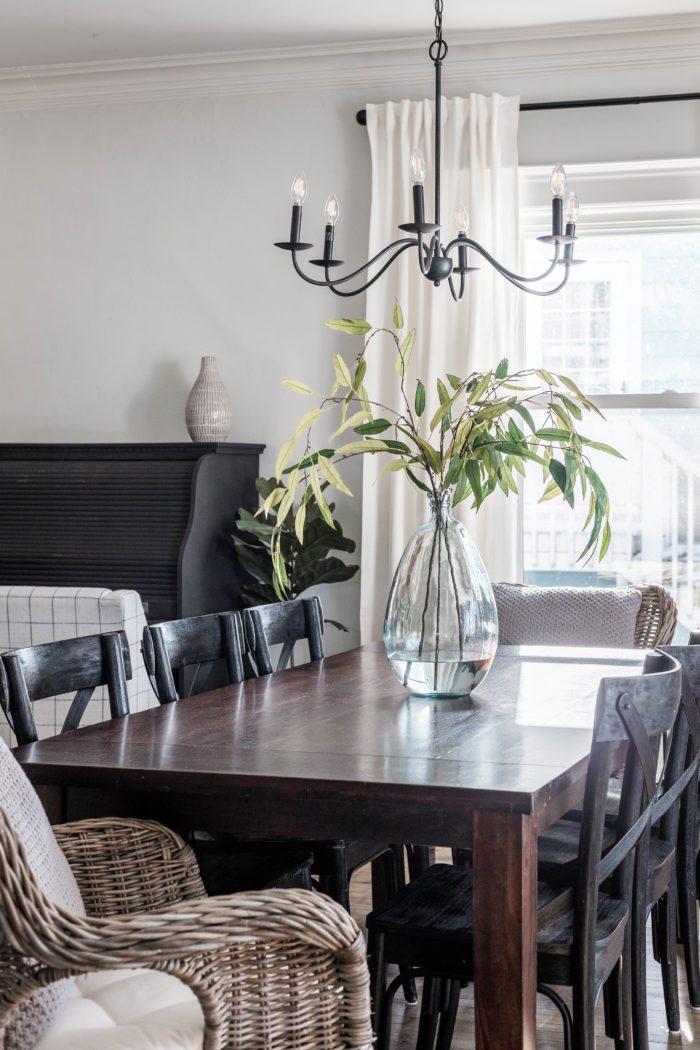 Black roll top desk in formal dining room provides hidden storage.
