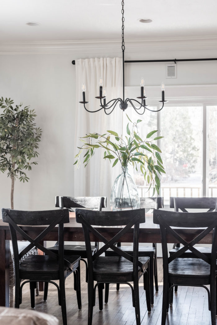 Simple formal dining room decor with black accents.