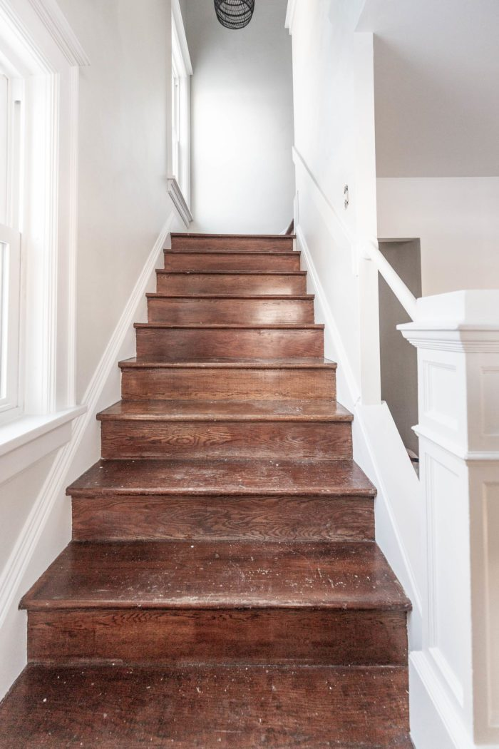 Clean Wooden Stairs before installing a runner.