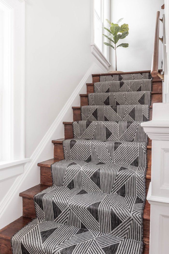 Black and White Stair Runner on wooden stairs.