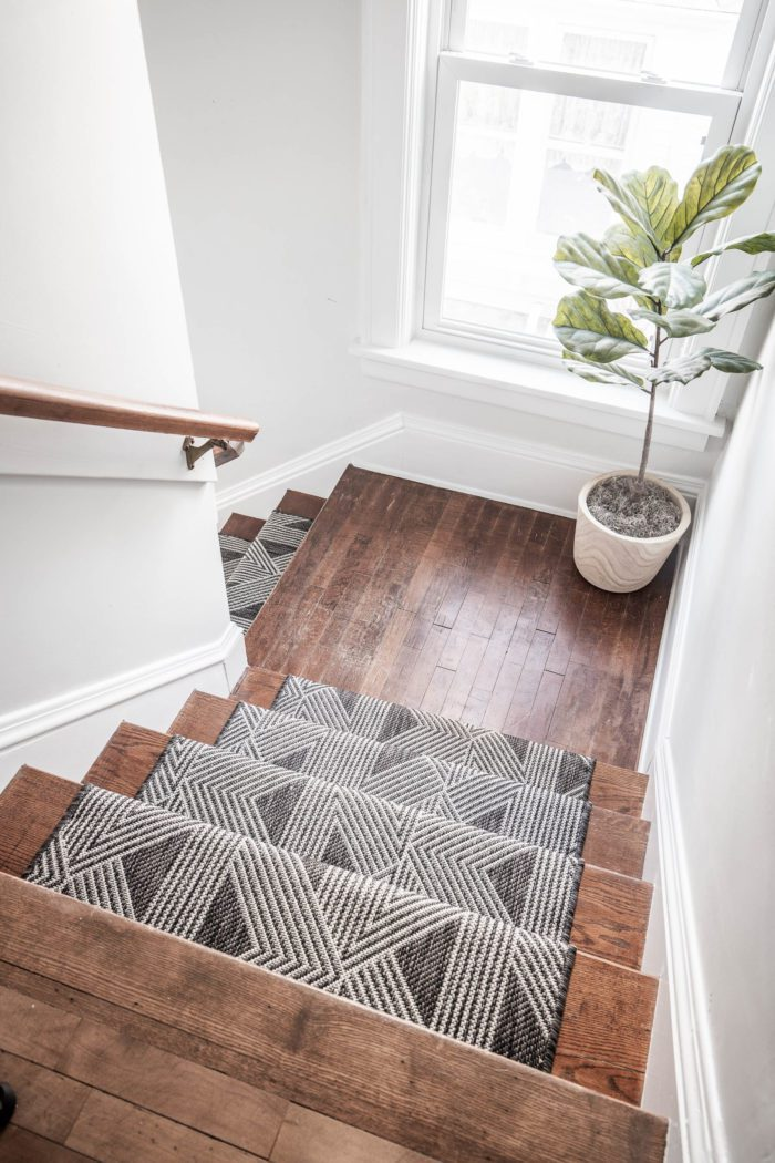 Stair runner on stairs with landing.