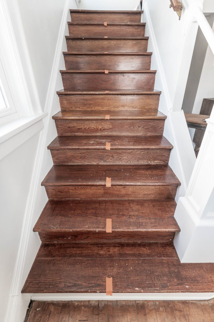 Mark the center of your wood stairs.