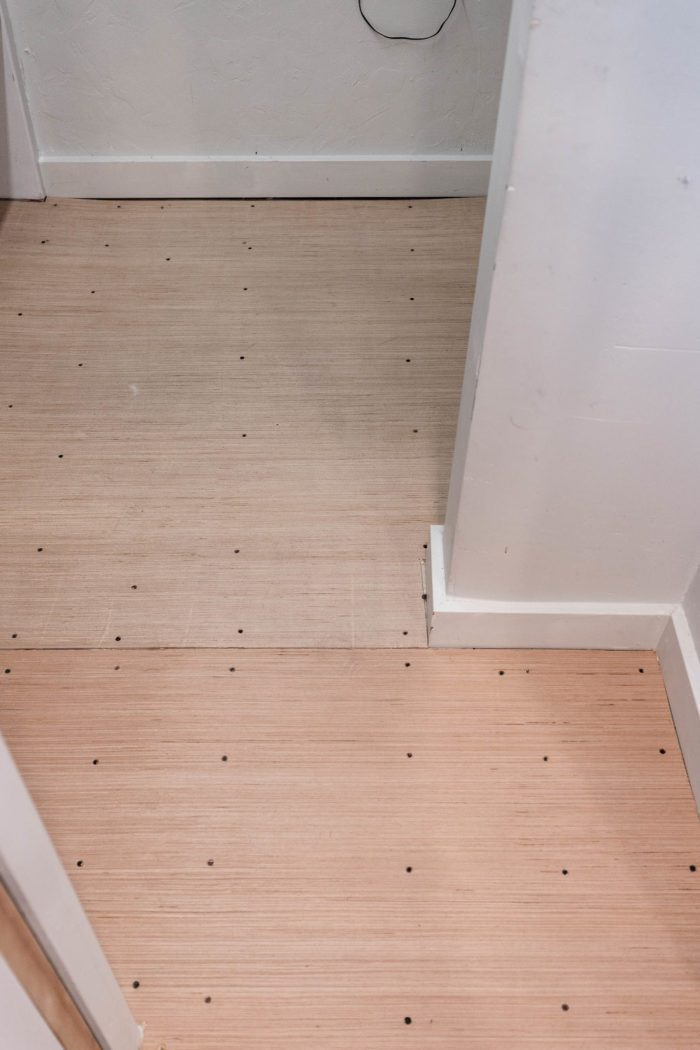 Screw down subfloor to prevent squeaking and broken tiles.