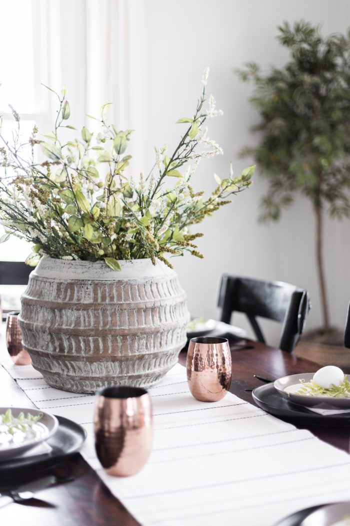 Use a planter as a centerpiece for a modern classic Easter tablescape.