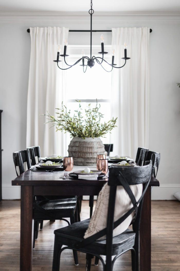 Modern Classic Easter Tablescape with dark wood table, black chairs and a simple centerpiece.