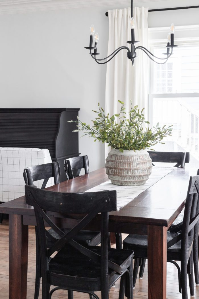 Dark Wood Dining Room table with black chairs.