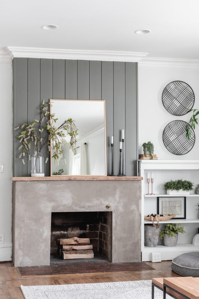 Concrete and shiplap fireplace with spring decor.