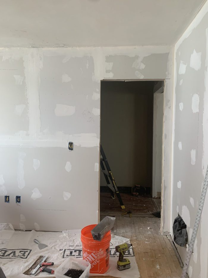 Progress photo of Master Bedroom. The built in closet has been removed and the doorway moved over to allow for the hallway to be extended.