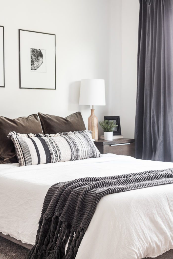 Take a tour of this Cozy Modern Scandinavian Master Bedroom with a light airy feel and high contrast decor.