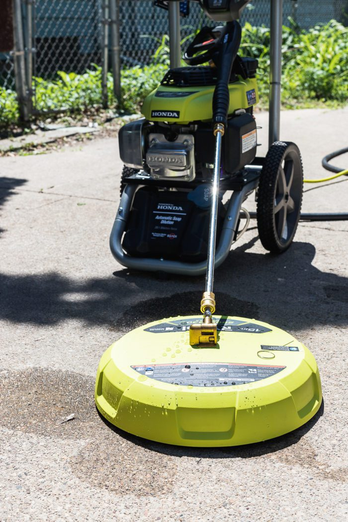 Use a surface cleaner with a pressure washer to clean your driveway and sidewalks.