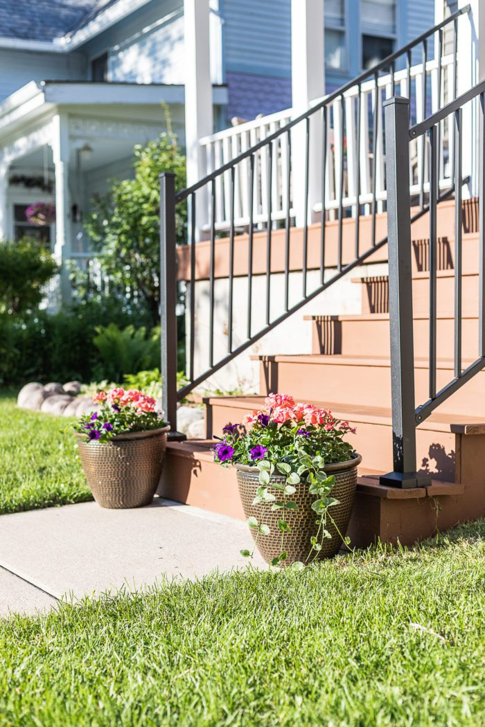 Front porch steps with planters for curb appeal.