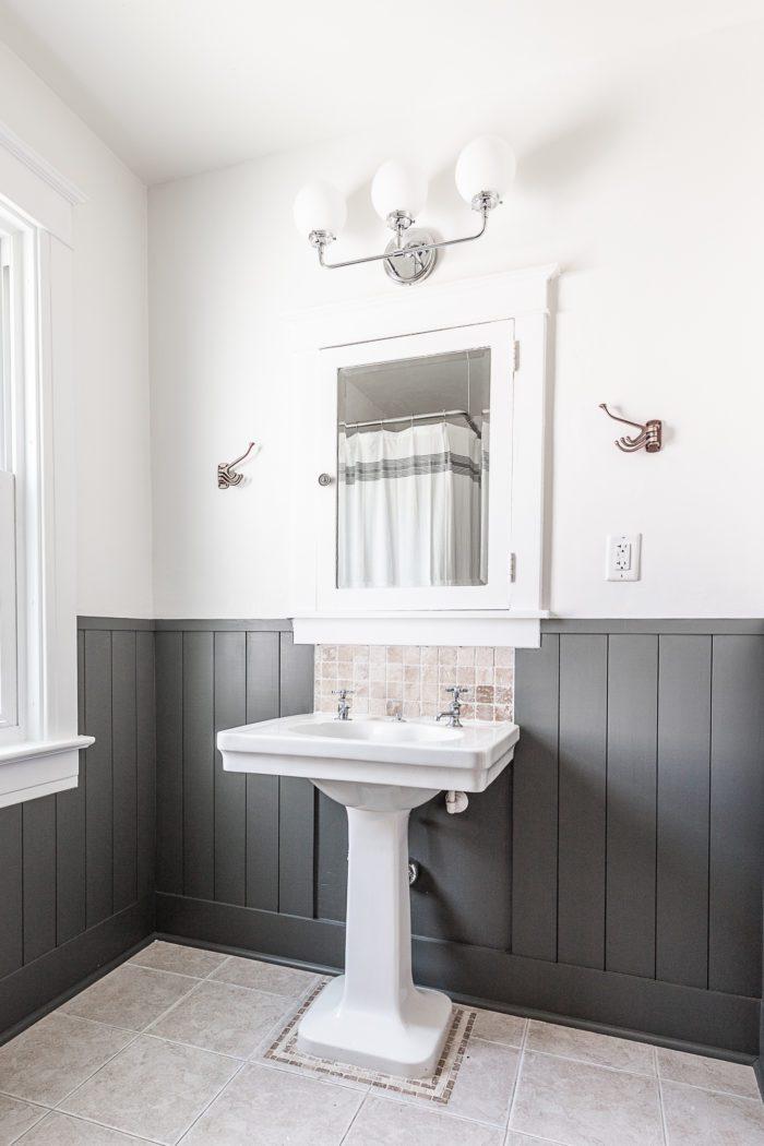 pedestal sink with vertical shiplap and medicine cabinet