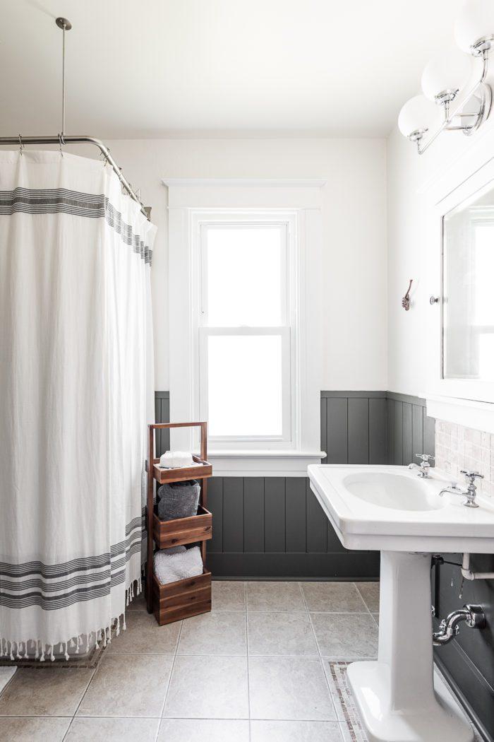 two sided bathtub in bathroom with window