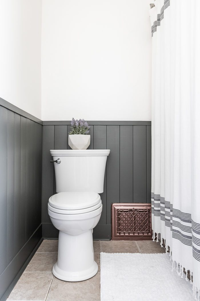 Dark Green vertical shiplap in boys bathroom.