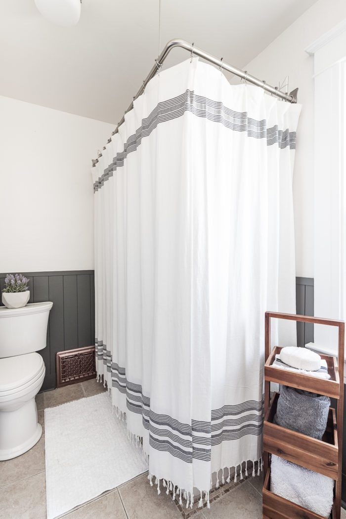 Using two shower curtains for two sided tub.