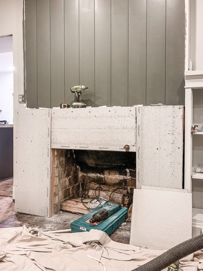 cement board covering old brick fireplace.