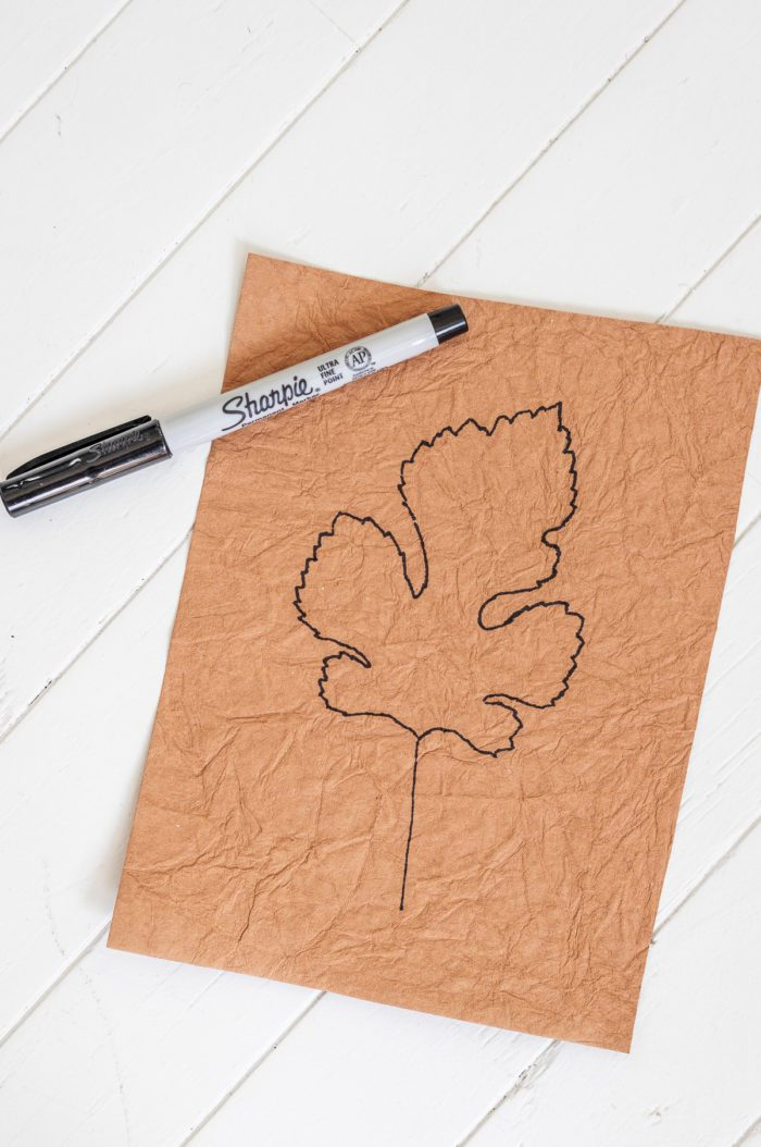 Trace a leaf on scrapbook paper and frame it for Easy Fall Decor