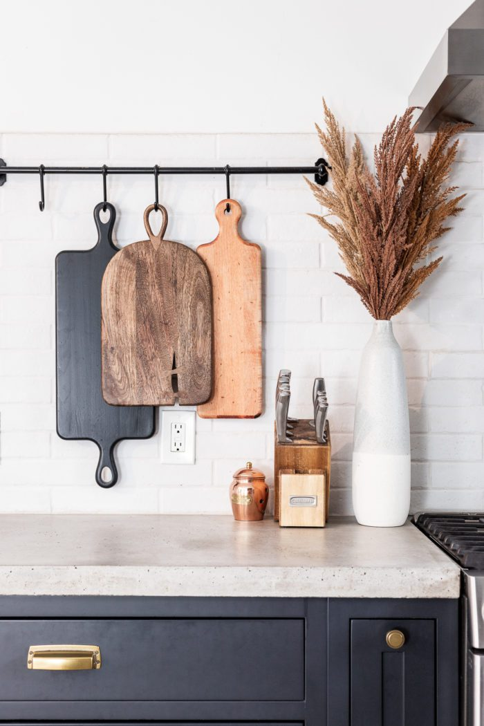 Hanging cutting boards on kitchen backsplash with Fall Decor.