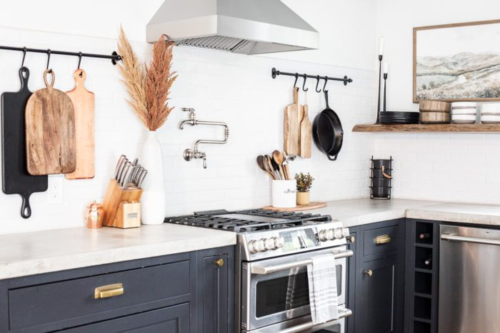 Open Shelving with hanging racks above concrete counter tops with Fall Decor.