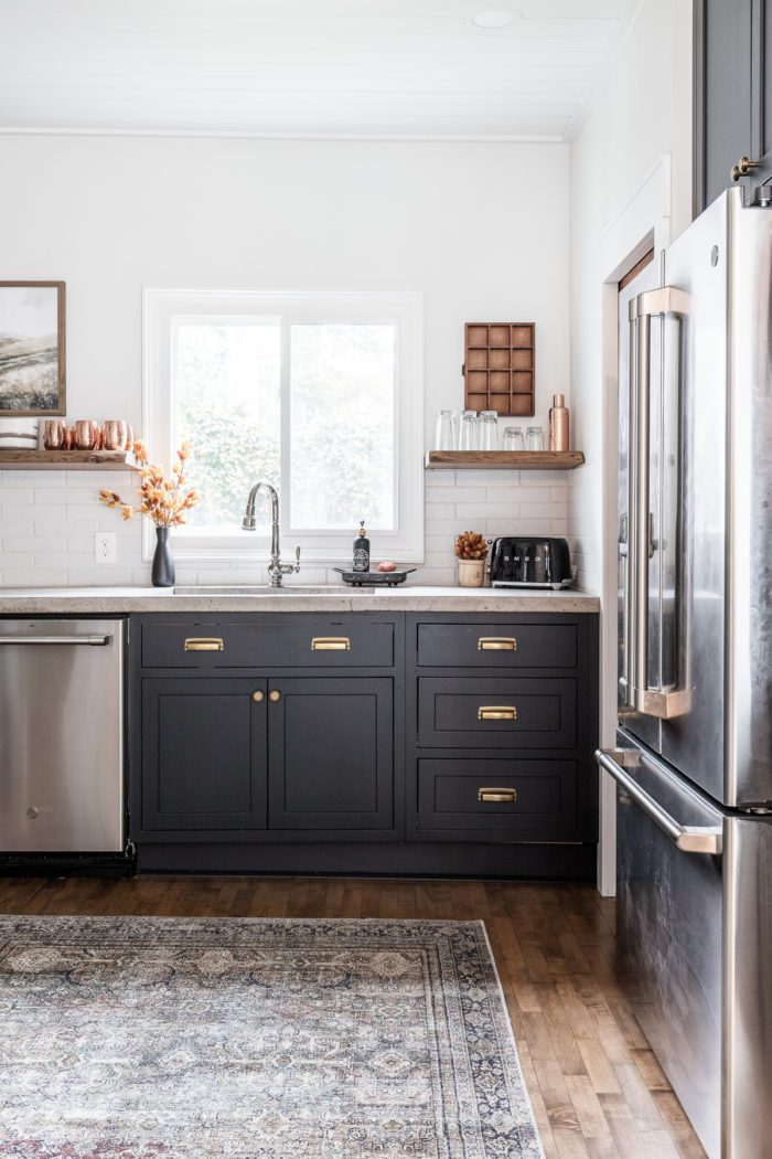 Fall kitchen decor with black cabinets and open shelving.