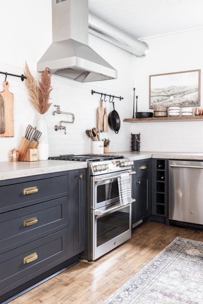 Black Kitchen Cabinets, Brass hardware, brick subway tile and open shelving with Fall Decor
