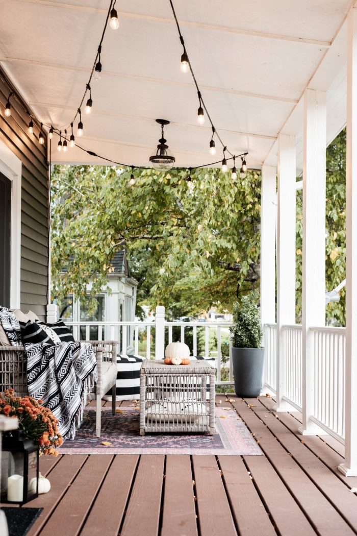Front Porch Decorated for Fall with throw blankets and pillows.