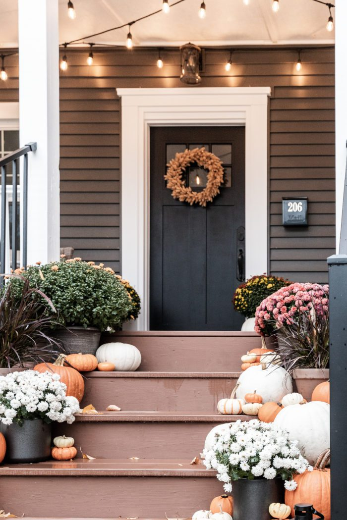 Pumpkins and Mum on Front Porch Stairs and wreath on Door