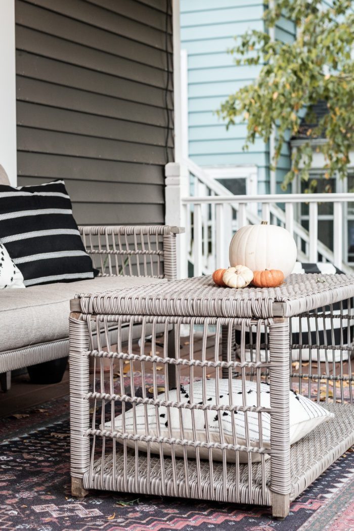 coffee table on front porch decorated with pumpkins