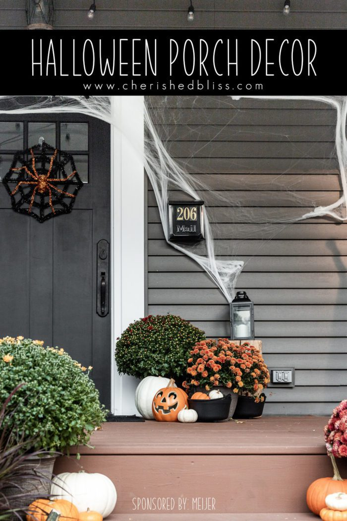 Halloween Porch Decor with spider webs, mums, and pumpkins