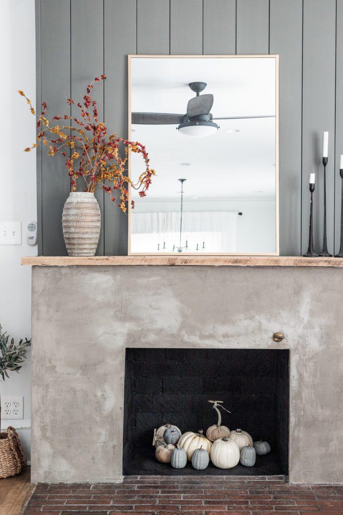 Simple fall decor on a fireplace mantel.