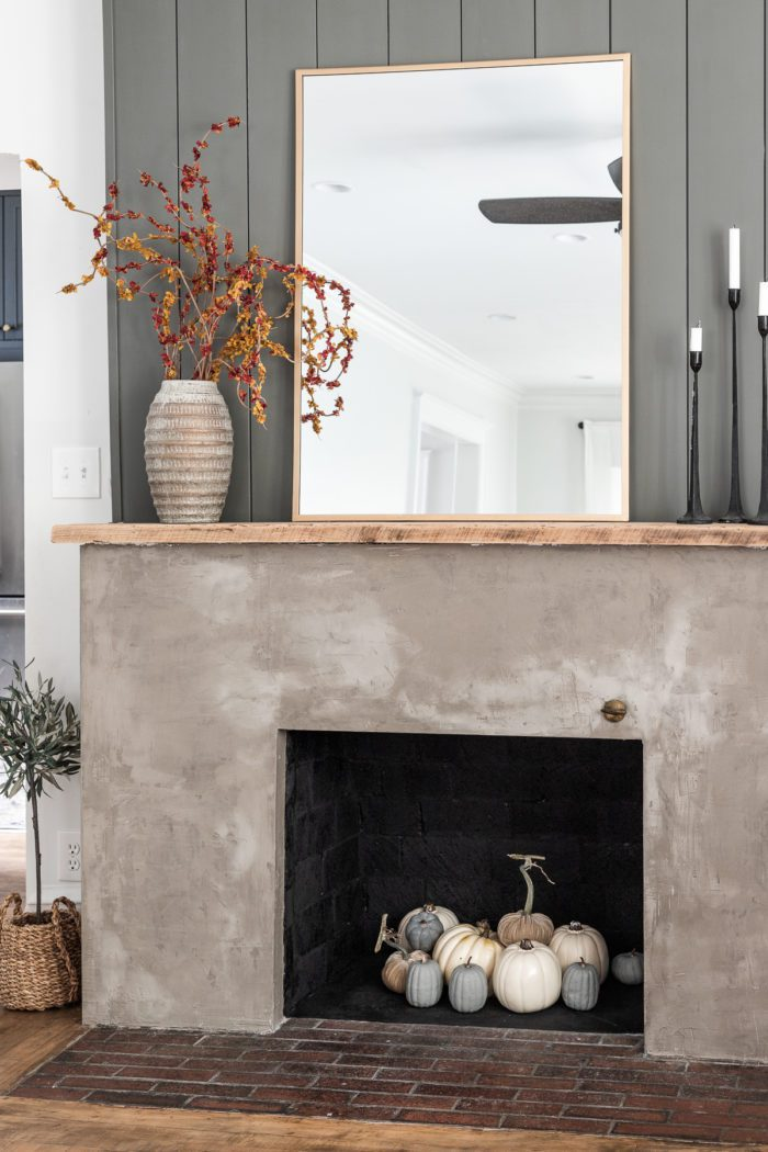 Concrete fireplace with pumpkins.
