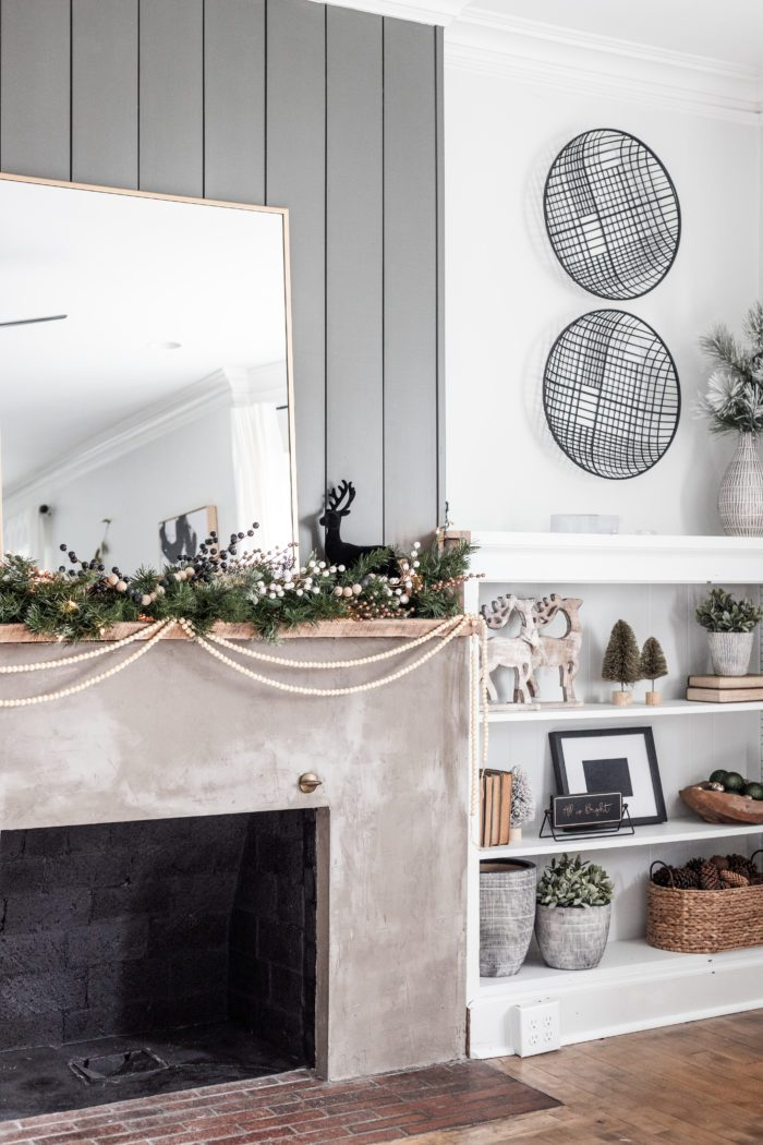 Winter Decor on fireplace mantel with built ins.