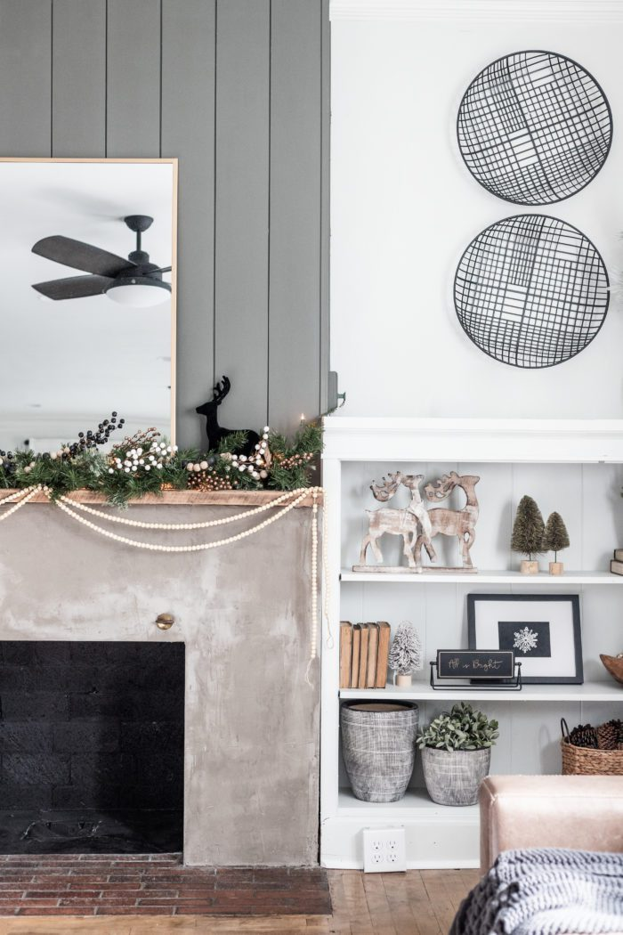Cozy Winter Decor on a Concrete Fireplace with built ins.