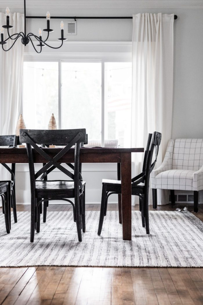 Dining Room with Gray striped rug and simple winter decor.