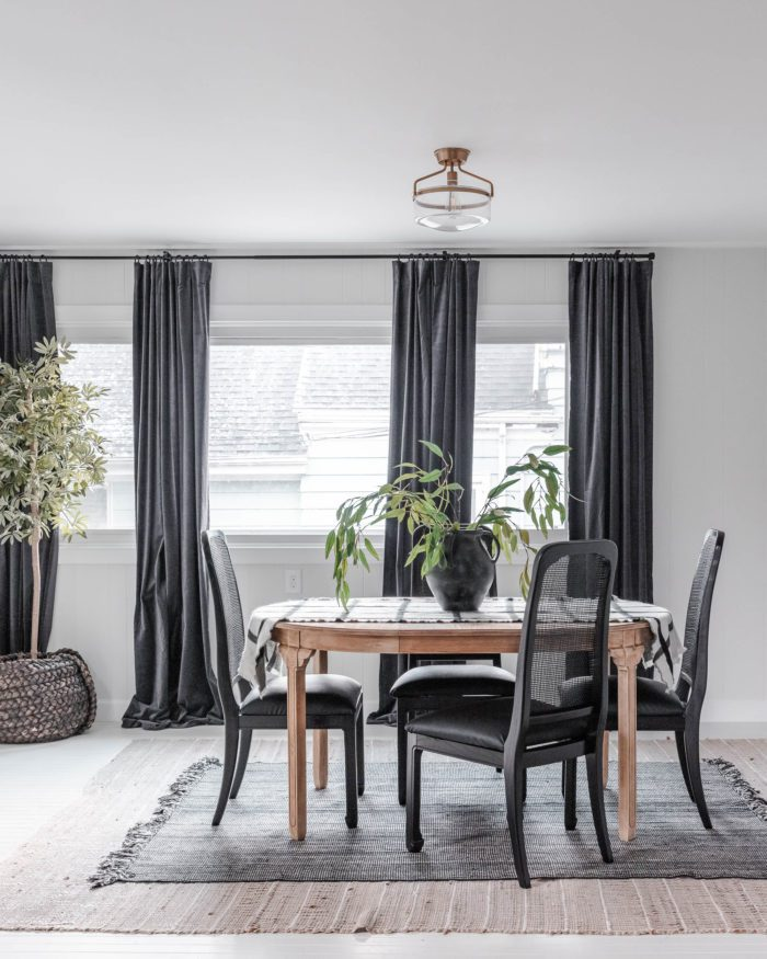 White Walls in Breakfast Room with Black Curtains. You won't believe this before and after.